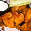 Постер, плакат: Food and Drink An appetizer of spicy saucy Buffalo chicken wings