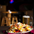 Food and Drink. An appetizer of spicy nachos with a frosty mug of beer — Stock Photo #21371385