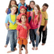 Diversity. Group of little girls and boys standing together in colorful clothes to symbolize diversity — Stock Photo
