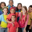 Stock Photo: Diversity. Diverse group of children wearing vibrant colorful clothes.