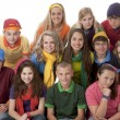 Diversity. Group of teenage girls and boys sitting together in colorful clothes — Stock Photo #21372637