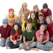 Foto Stock: Diversity. Group of teenage girls and boys sitting together in colorful clothes