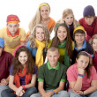 Diversity. Group of teenage girls and boys sitting together in colorful clothes — Stockfoto