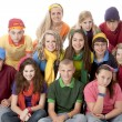 Diversity. Group of teenage girls and boys sitting together in colorful clothes — Stock fotografie