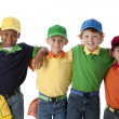 Diversity. Group of four diverse little boys with their arms around each other — Stock Photo