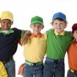 Diversity. Group of four diverse little boys with their arms around each other — Stock Photo #21372933