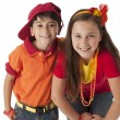 Real. Smiling caucasian  brother and sister wearing a bright red and orange clothing - Stock Photo