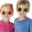 Real.  Caucasian twins a little boy and little girl wearing silly sunglasses — Stock Photo