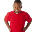 Real. Black little boy wearing a bright red shirt with his hands on his hips — Stock Photo #21373497
