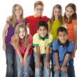 Diversity. Multi-racial group of seven children in colorful clothing standing together as a team — Stock Photo