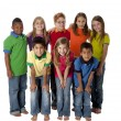 Foto Stock: Diversity. Multi-racial group of eight children in colorful clothing standing together as team