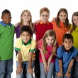 Diversity. Multi-racial group of eight children in colorful clothing standing together as a team — Stock Photo #21373553