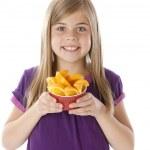 Healthy Eating. Caucasian little girl holding bowl of freshly sliced oranges — Stock Photo #21373707