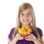 Healthy Eating. Caucasian little girl holding bowl of freshly sliced oranges — Stock Photo #21373711