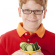 Healthy Eating. Caucasian  little boy holding bowl of freshly sliced  cucumbers — Stockfoto