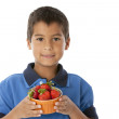 Healthy Eating. Caucasian little boy holding a fresh juicy bowl of strawberries — Stock Photo