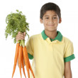 Healthy Eating. Hispanic little boy holding a bunch of carrots — Stock Photo