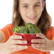 Healthy Eating. Caucasian little girl holding a bowl of broccoli — Stock Photo