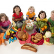 Healthy Eating. Diverse  group of children holding baskets with the food groups of fruits - Stock Photo