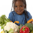Healthy Eating. Black little boy holding a basket with an arrangement of vegetables — Stock Photo