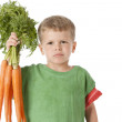 Healthy Eating. Caucasian  little boy holding a bunch of carrots — Stock Photo