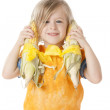 Healthy Eating. Caucasian little girl holding two ears of corn up to her ears — Stock Photo #21373885