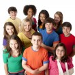 Stock Photo: Diversity. Group of teenage girls and boys in colorful clothing standing together as a team