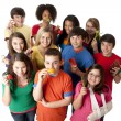 Healthy Eating. Diverse  group of teenage girls and boys with healthy fruits and vegetables — Stock fotografie
