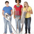 Stock Photo: Healthy Eating. Diverse group of teenagers holding oversized utensils a knife, fork and spoon.