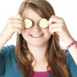Stock Photo: Healthy Eating. Caucasian girl holding cucumbers up to her eyes