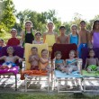 Summer Swimming.  Group  of diverse children relaxing after having fun in the summer sunshine - Stock Photo