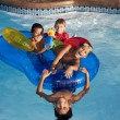 Summer Swimming.  Group of little boys playing together in the summer sun with water toys - 图库照片