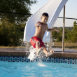 Summer Swimming.  Hispanic little boy having fun in the summer sun on a water slide — Foto Stock