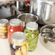 Canning. Pressure cooker used for canning homegrown fruits and vegetables fresh from garden — Stock Photo #21374375