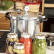Canning. Pressure cooker used for canning homegrown fruits and vegetables fresh from the garden — Stock Photo #21374383