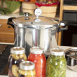 Canning. Pressure cooker used for canning homegrown fruits and vegetables fresh from the garden — Stock Photo