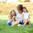 Real. Caucasian family outdoors with the mother and her two daughters — Stock Photo