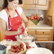 Stock Photo: Baking. Mixed race young adult wombaking fruit pies for dessert in kitchen