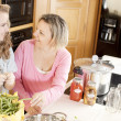 Canning. Caucasimother and teenage daughter canning homegrown vegetables — Stock Photo #21374839