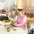 Stock Photo: Canning. Laughing caucasian laughing mother and teenage daughter canning homegrown fruits and vegetables