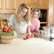 Canning. Caucasian mother helping her teenage daughter can homegrown fruits and vegetables — Stock Photo #21374855