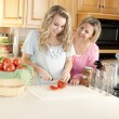 Canning. Caucasian mother helping her teenage daughter can homegrown fruits and vegetables — Stock Photo #21374859