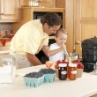 Canning. Father and son canning homegrown fruits for preserves — Stock Photo