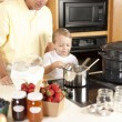 Canning. Father and son canning homegrown fruits for preserves — Stock Photo #21374957