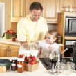Canning. Father and son canning homegrown fruits for preserves — Stock Photo #21374973