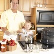 Canning. Father and son canning homegrown fruits for preserves — Stock Photo #21374985