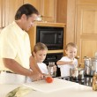 Stock Photo: Canning. Father and his two sons canning homegrown fruits and vegetables