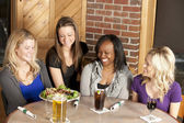 Women enjoying a girl's night out together at a restaurant bar — Stock Photo