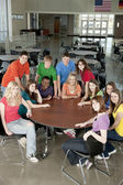 Education. Group of teenage high school students together as friends or a team, in colorful clothes — Stock Photo