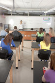 School Science. Teacher instructing students — Stock Photo